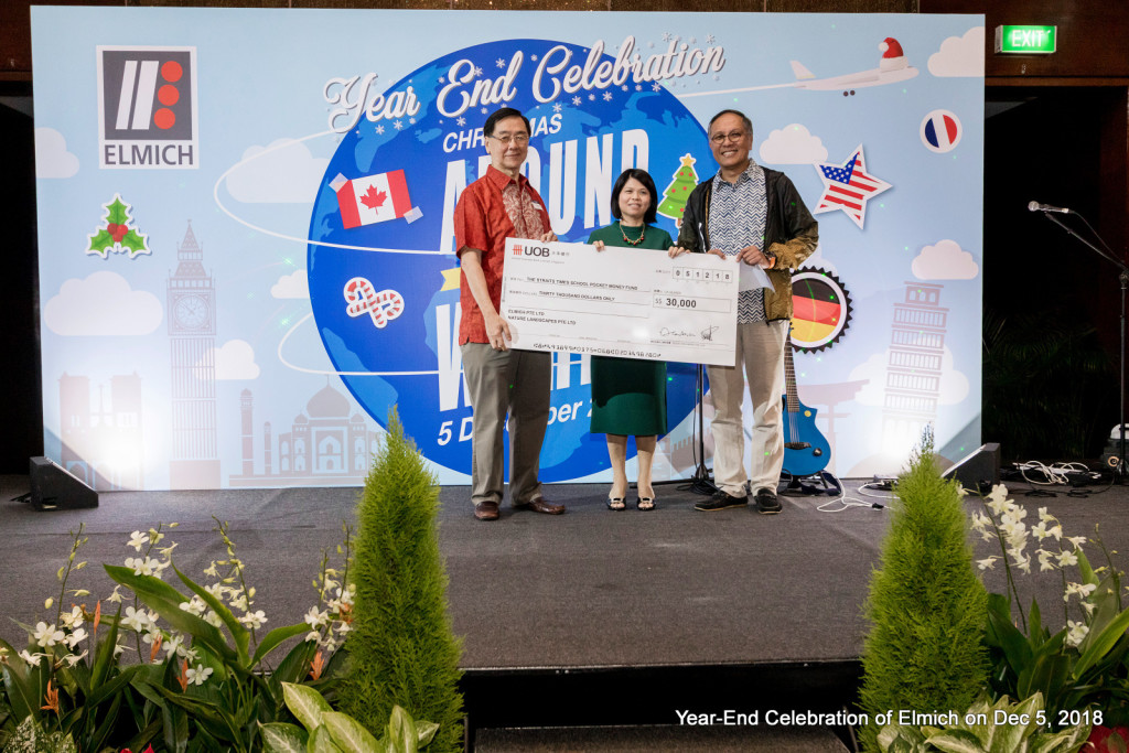 Mr Alan Lee (left) and Mr Michael Teh from Elmich presenting a cheque for their donation to Ms Tan Bee Heong, general manager of The Straits Times School Pocket Money Fund.