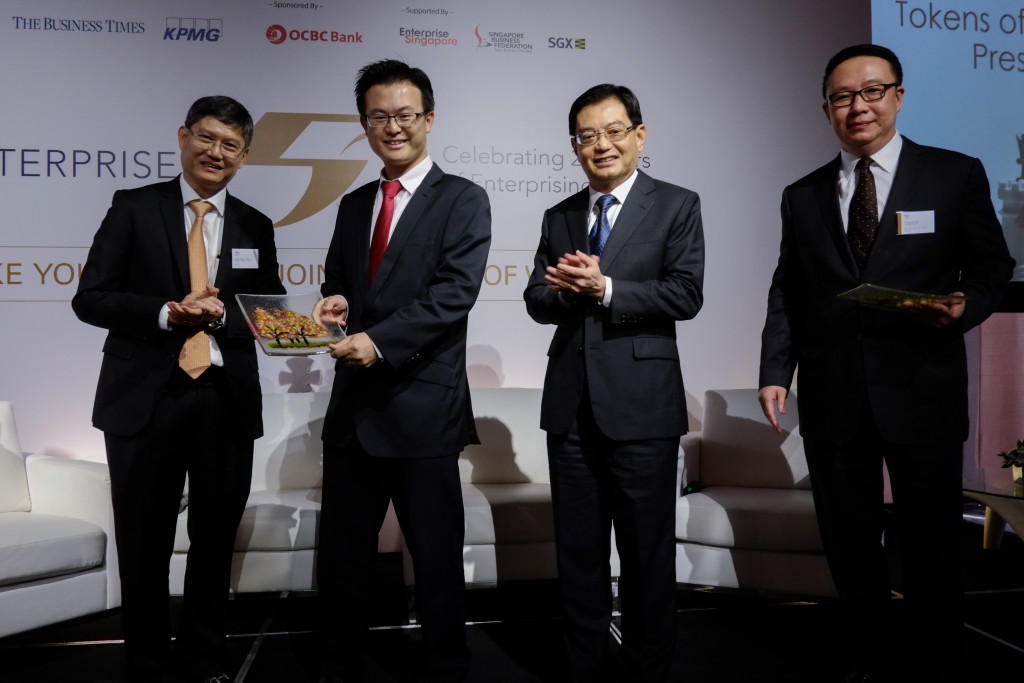 (From left) Mr Ong Pang Thye, managing partner of KPMG Singapore; Mr Raymond Lim, associate director of Elmich; Finance Minister Heng Swee Keat ; and Mr Toby Koh, group managing director at Ademco Security Group. (Photos from https://enterprise50.org/gallery/)