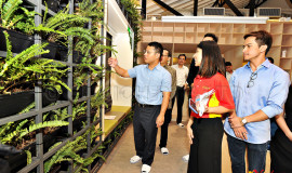 Guest of Honor, Mr Desmond Lee, viewing the VersiWall® GP LW green wall (Photo from Heartware Network)